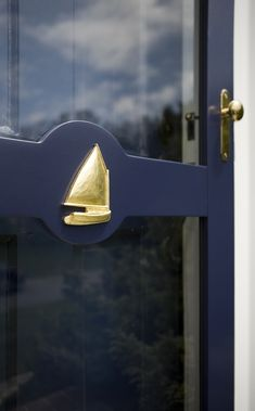 Sailboat applique on a custom screen-door.