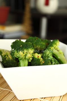 Asian style broccoli-I changed the recipe to be fat free, not flavor free- steam broccoli and toss with seasonings //2  heads of broccoli  , dash hot sauce  1 clove of garlic, grated  1 tsp sesame seeds  2 tsp soy sauce  Juice from ½ lime