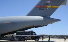 The latest addition to the military assets battling the Waldo Canyon Fire is the wildland team from Vandenberg Air Force Base. The 18-member hot shot crew and their vehicles were flown to Colorado in the belly of a C-17 Globemaster.