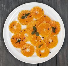 Sliced oranges with orange flower water, honey, lavender, and mint. Simple, sweet with floral overtones = delicious.