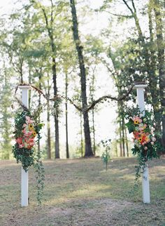 columns as a ceremony arch, photo by Cassidy Carson http://ruffledblog.com/louisiana-backyard-wedding #weddingideas #ceremonies