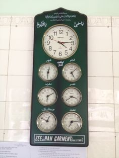 Clock inside the main mosque in Saigon showing the times of several Islamic countries around the world. I've forgotten all my Arabic... someone want to help me out with identifying the cities?
