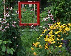 19 Amazing uses for old picture frames in the garden Deborah Sullivan's large red frame simply 'frames' her garden
