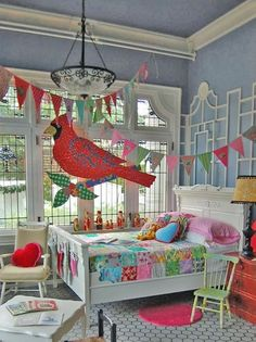I love the whimsy and color of this little girl's room. <3