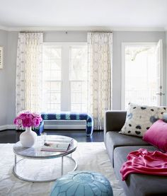 Sally Wheat's den features an eclectic mix of patterns, plush textiles, and vibrant colors | domino.com
