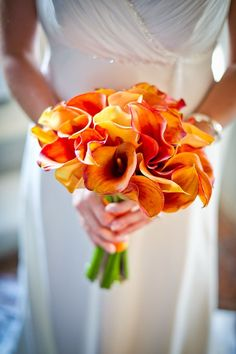 tuscan wedding. beautiful red orange lily bouquet