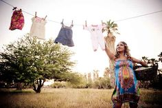 Give an nod to the adorable laundry you'll be doing soon. | 38 Insanely Adorable Ideas For Your Maternity Photoshoot