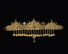 Diadem with Kinnaris (Half-Bird, Half-Female Creatures) Date: 9th–10th century Culture: India (Jammu & Kashmir, ancient kingdom of Kashmir) Medium: Gold inset with garnet Dimensions: H. 4 5/8 in. (11.8 cm); W. 11 1/8 in. (28.3 cm) Classification: Jewelry Credit Line: Gift of The Kronos Collections, 1988