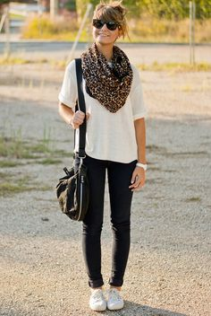 Leopard print scarf, white t-shirt, dark wash skinny jeans, and white sneakers.