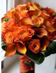 orange wedding flowers with aspidistra leaves