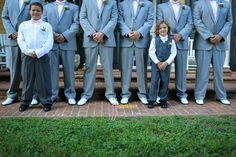 grey suits, white shoes, pink bow ties