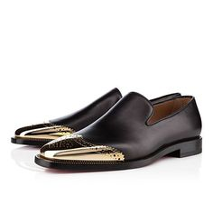 Christian Louboutin black leather and golden toecap