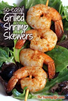 Spicy Grilled Shrimp Skewers. So easy! Make them spicy or not-so-spicy. Serve  them on salad, in tacos, or as an appetizer. From TheYummyLife.com.