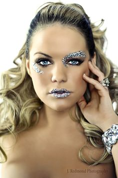 Beautiful blue eyes with perfect lashes adorned with crystals and glitter.