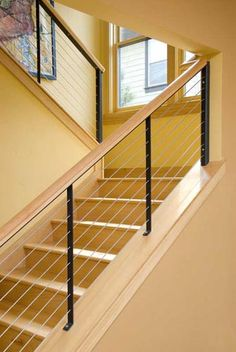 cable stair railing: welded powder-coated steel with stainless cables (Wingnut Portfolio)