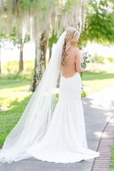 This Katie May Collection dress is stunning: http://www.stylemepretty.com/little-black-book-blog/2014/09/18/boho-chic-travel-themed-orlando-wedding/ | Photography: Amalie Orrange - http://amalieorrangephotography.com/