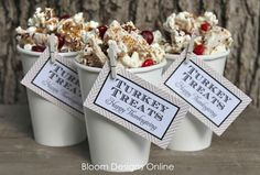 Toffee Popcorn Recipe served in cups with a clothespin sign.
