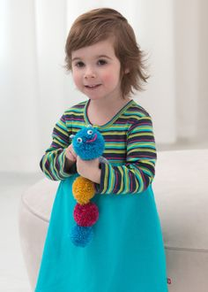 This Pom Pom Caterpillar is such an adorable homemade toy for kids to make. Little ones will love learning how to make pom poms for this yarn project!