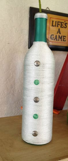 String wrapped Bottle with Buttons