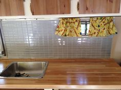iridescent tiles, butcher block counter