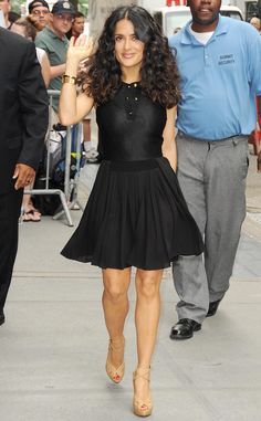 Salma Hayek shows off her legs and smile in a lovely black number.