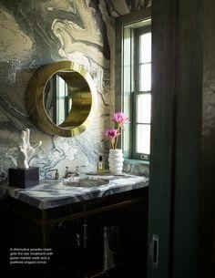 Marbled walls + brass mirror.