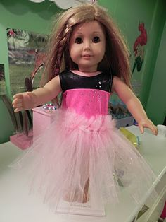 Not that she playes w her American Girl doll any more, but this is a cuted DIY American Girl Tutu if she decides to dress her up and leave her.:)