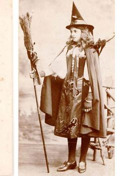 Oh how I adore her wonderful witch's costume (complete with frightened toy cat on the shoulder). #witch #vintage #Halloween