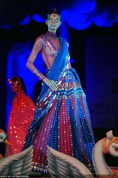 Nayanika Chatterjee showcases a creation by designer Manish Arora on Day 4 of Delhi Couture Week, held in New Delhi, on August 03, 2013.