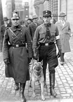 February 27, 1933 - a regular policeman (left) and his dog on street patrol side-by-side with a Nazi auxiliary after the Reichstag fire in Berlin.