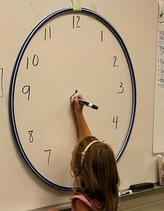 teaching to tell time with a hula-hoop
