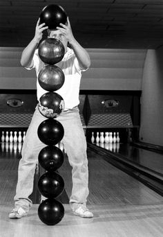 How to Stack Bowling Balls: Place the thumb hole of the first ball down. The next thumb hole goes on top of the center of the first ball. www.people.com/... Image credit Keith Philpott #Bowling_Ball_Stack
