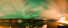 Northern Lights peaking through the clouds as seen from the deck of the Great Lakes Research Center at Michigan Tech. Panorama from the early hours of June 1st, 2013.