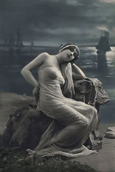 French risque postcard siren  Lyres were dying in the harmonious air,  Languorous exhaltations came from the calyxes  And the swooning sailors felt the slow delight  Of velvet kisses settling on their eyes.  Albert Samain