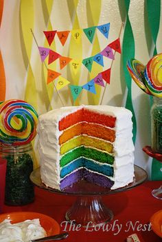 Rainbow cake. I'd cover the whole thing with hundreds and thousands! And sprinkle pop rocks on top and/or put wizz fizz between the layers.