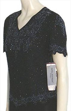 1980s black silk blouse covered in swirling black bugle beads. V neckline is embellished with tight rows of beads and neckline cuffs and bottom are adorned with beads that form a floral, leaves motif. All bead work and ornamentation has been done completely by hand.