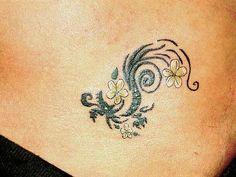 Such a cute, feminine dragon tattoo