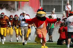 Cy leads the team to the field. #CycloneFB #CountdowntoKickoff
