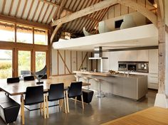 This eco barn situated in the United Kingdom was completely redesigned by Bulthaup by Kitchen Architecture