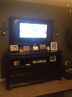 Our dresser turned into tv stand project idid last spring (should of taken a before) And the frame we did for our tv