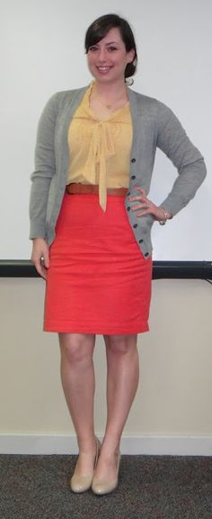 yellow bow blouse, coral pencil skirt, grey cardigan, nude shoes