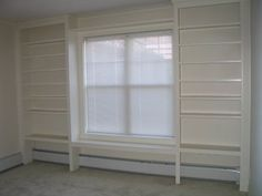 Built in bookcases and window seat that go over the baseboard heater