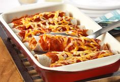 Mexican night is made easy with these simple enchiladas that are ready in just 30 minutes. Mexican-style tomato soup, cooked chicken and Colby Jack cheese combine to make a scrumptious filling for warm flour tortillas. Baked until hot and bubbling, these cheesy chicken enchiladas are sure to earn rave reviews.