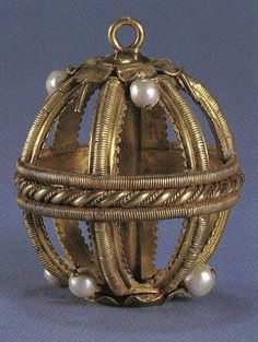 Gold and pearl pomander or musk ball probably belonging to Elizabeth I, English, 16th C. Found in the River Thames at Windsor. Because of the bad scents which accompanied Tudor England settings, pomanders or musk balls were part their lives. Usually, an orange (perhaps stuffed with cloves) was placed inside the ball to freshen the air with pleasant scents.