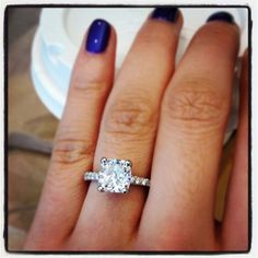 Wowza! Cushion cut diamond on a petite pave engagement ring.... loooove this <3