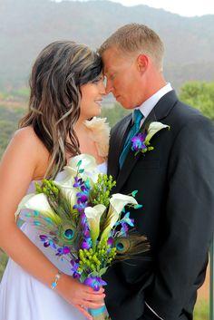 Bride & groom peacock wedding | teal purple and lime green wedding colors| peacock wedding colors | http://www.cheapshotsllc.com/weddings