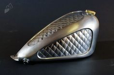 Not every gas tank has to be painted to look amazing. Killer custom tank by Rigid Hips.