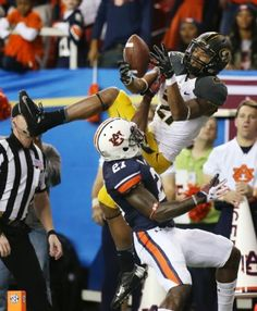 Missouri wide receiver Bud Sasser catches a pass in the endzone over Auburn defensive back Robenson Therezie but is unable to stay in bounds...