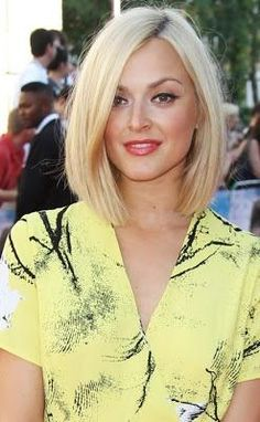 Chic platinum blonde long bob hairstyle with lovely red lips.