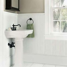 White-painted beadboard ties together the trim and acts as a backsplash for the pedestal sink. Moisture-resistant MDF with 2-inch bead, similar to shown, about $2.35 per sq. ft., Nantucket Beadboard